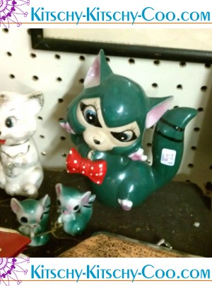 vintage cerimic racoon with red bowtie and babies