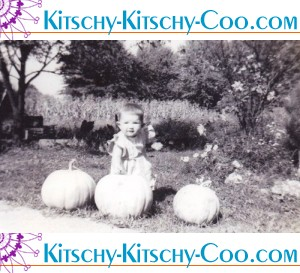 vintage toddler baby with pumpkins